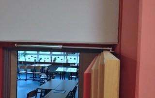 Amortisseur-limiteur d'ouverture en porte d'école